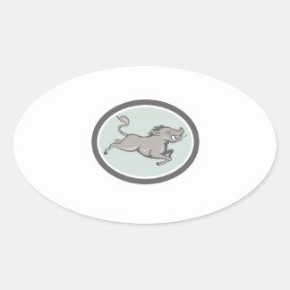 Balénoptère de sanglier sautant la bande dessinée stickers ovales
