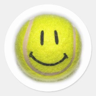 Balle de tennis souriante de visage sticker rond
