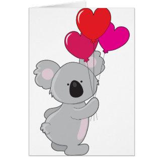 Ballons de coeur de koala carte de vœux