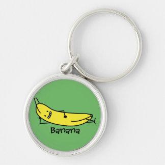 Banane qui sourit, fixant et détendant porte-clé rond argenté