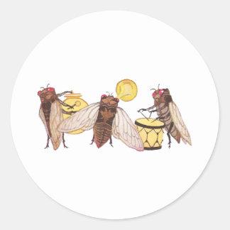 Bande de cigale avec le gong, la trompette et le adhésifs ronds
