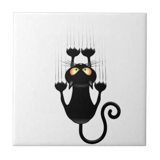 Bande dessinée drôle de chat noir rayant le mur petit carreau carré