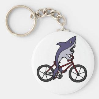 Bande dessinée idiote de bicyclette d'équitation d porte-clé rond