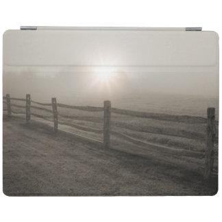 Barrière et rayon de soleil par le brouillard près protection iPad