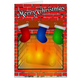 Bas au-dessus d'une carte de Noël de cheminée