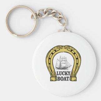 bateau chanceux en mer porte-clé rond