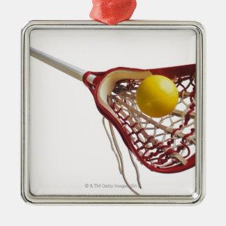 Bâton et boule de lacrosse ornement carré argenté