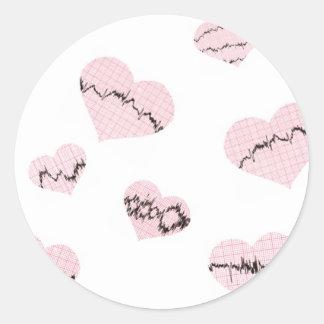 Battements de coeur sticker rond