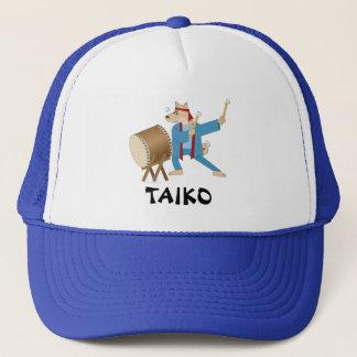 Batteur de Taiko de chien de bande dessinée de Casquette
