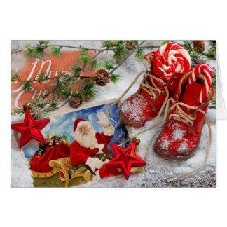 Beau Père Noël et sa carte de Noël de furets