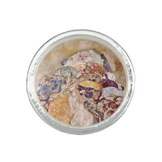 Bébé dans l'édredon brillamment coloré bague avec photo