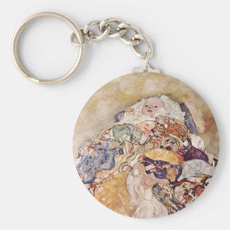 Bébé dans l'édredon brillamment coloré porte-clés