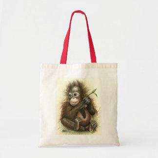 Bébé d'orang-outan avec le feuille sac fourre-tout