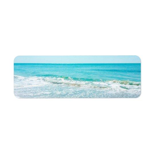 Bécasseau tropical de ressacs de sable de plage de étiquette d'adresse retour