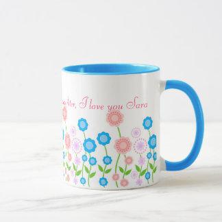 Belle tasse de fleurs pour la fille