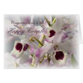 Belles fleurs d'orchidées épousant la carte de