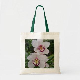 Belles fleurs tropicales d'orchidées blanches sac