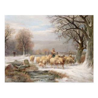 Bergère avec son troupeau dans un paysage d'hiver carte postale