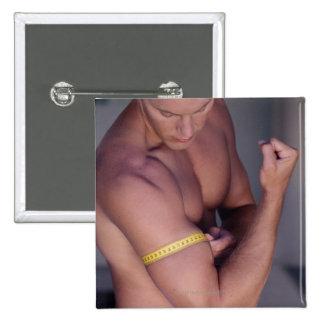 Biceps de mesure d'homme badges