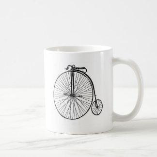 Bicyclette antique de quart de penny de penny mug
