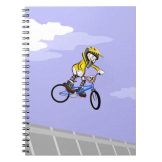 Bicyclette BMX extrême pirouettes dans l'air Carnet