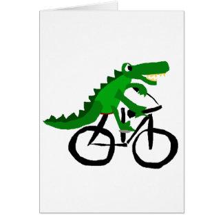 Bicyclette drôle d'équitation d'alligator cartes