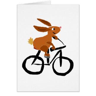 Bicyclette drôle d'équitation de lapin de Brown Cartes