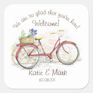 Bicyclette rouge avec l'accueil de panier sticker carré