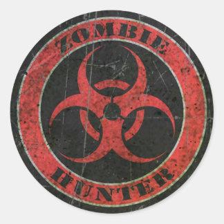 Bio chasseur rouge et noir rayé de zombi de risque sticker rond