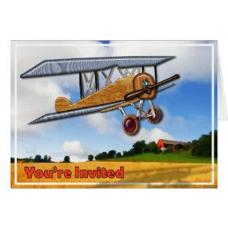 Biplan en bois au-dessus d'invitation de partie de carte de vœux