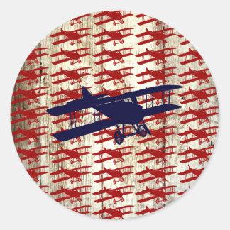 Biplan vintage sur les cadeaux en bois d'aviation sticker rond