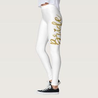 Blanc de jeune mariée et pantalon de yoga de leggings