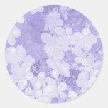 Bleu avec des fleurs de l'eau sticker rond