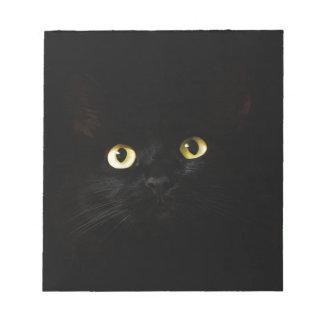 Bloc-note Chat de plots réflectorisés de vue de chat noir