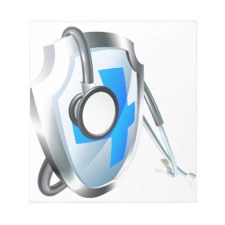 Bloc-note Concept médical de bouclier et de stéthoscope