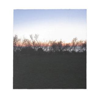 Bloc-note Coucher du soleil de mer avec la silhouette