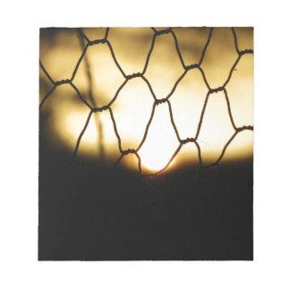 Bloc-note Coucher du soleil par la barrière