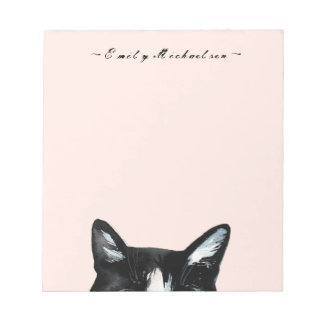 Bloc-note Le chat jetant un coup d'oeil curieux adorable et