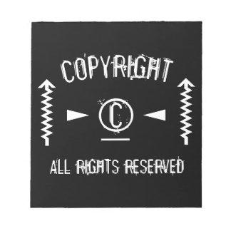 Bloc-note Symbole de Copyright tous droits réservés avec des