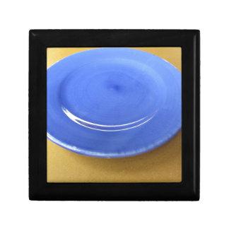 Boîte À Souvenirs Plat en céramique bleu de couleur vide sur le