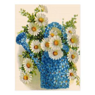 Boîte d'arrosage bleue de fleur carte postale