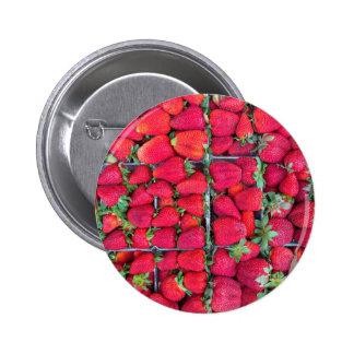 Boîtes remplies de fraises rouges badges
