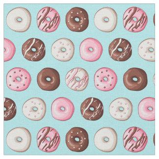 Bonbons à beignet sur la copie bleue de tissu