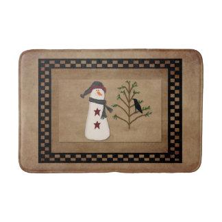 Bonhomme de neige avec le tapis de bain d'arbre