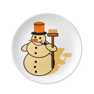 Bonhomme de neige avec une bande dessinée de balai assiette en porcelaine