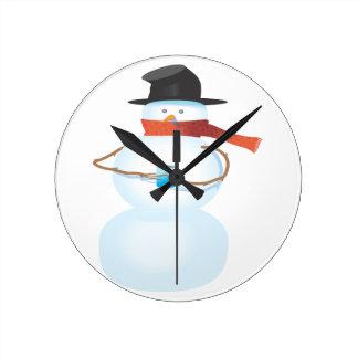 Bonhomme de neige froid horloge ronde