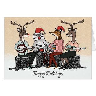Bonnes fêtes carte de musique de tronçon d'animaux