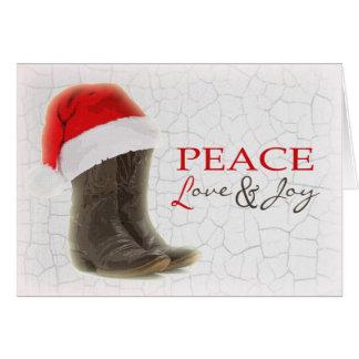 Bottes de cowboy de carte de Noël de pays et