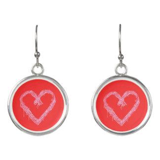 Boucles D'oreilles Coeur blanc avec l'arrière - plan d'un rouge