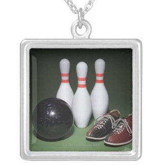 Boule de bowling pendentif carré